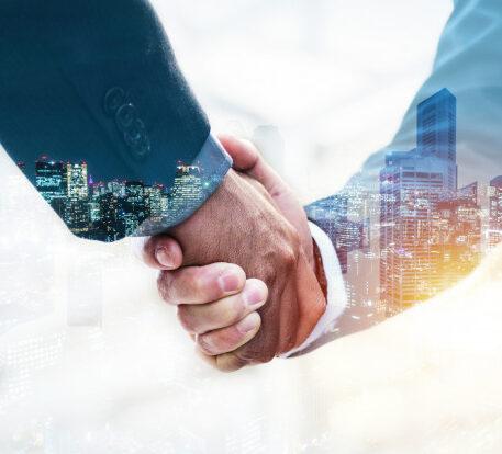 welcome-double-exposure-business-man-partner-handshake_33829-169
